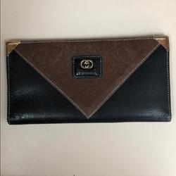 Gucci Accessories | Gucci Wallet Black And Brown With Gold Insignia. | Color: Black/Gold | Size: 6 X 3.5