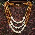 Anthropologie Jewelry | Anthropologie Triple Strand Beaded Necklace | Color: Brown/White | Size: Os