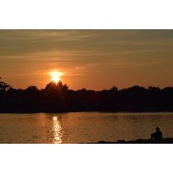 Water Lake Sunset Silhouette Man Sitting Shore-20 Inch By 30 Inch Laminated Poster With Bright Colors And Vivid Imagery-Fits Perfectly In Many Attractive Frames