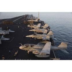 Aircraft parked on the flight deck of USS Dwight D. Eisenhower at the end of another flying day in the Arabian Sea during Operation Enduring Freedom operations Poster Print