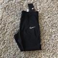 Nike Pants & Jumpsuits | Nike Womens Tight Fitcrop Length Leggings | Color: Black | Size: Small