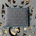 Michael Kors Accessories | Michael Kors Cooper Slim Billfold Neon Edge Wallet | Color: Black/Blue | Size: Os