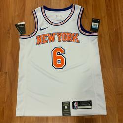 Nike Shirts   Nike Kristaps Porzingis New York Knicks Jersey   Color: Orange/White   Size: M