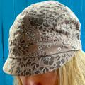 Anthropologie Accessories   Anthropologie Cadet Hat Floral Eyelet Tan + Silver   Color: Tan   Size: Os