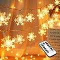 BrizLabs Snowflake Lights, 40 LED 16.08ft Christmas Lights with Remote, Twinkle Snowflake String Lights Battery Operated, 8 Modes Xmas Light Waterproof for Outdoor Indoor Room Decorations, Warm White