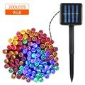 Suzicca Solar Powered String Light 100/200 LEDs 2 Lighting Modes Christmas Lights IP65 Water-resistant Outdoor Hanging Fairy Lighting for Holiday Party Living Room Garden Patio