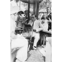 Buyenlarge Enrico Caruso Leans Back on Chair Holding A Board w/ Music - Photograp Print in Black/Brown/White, Size 42.0 H x 28.0 W x 1.5 D in