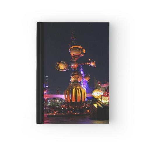 Tomorrowland Astro Orbitor in der Nacht Notizbuch