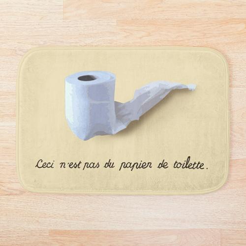 Dies ist kein Toilettenpapier. (Ceci n'est pas du papier de toilette.) Badematte