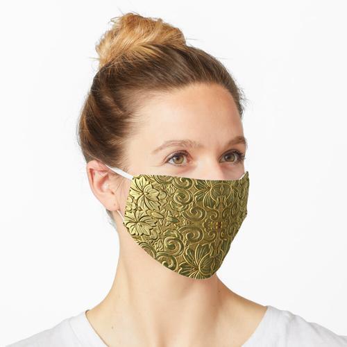 Dekoration in Gold Maske