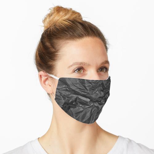Zerknittertes schwarzes Papier Maske