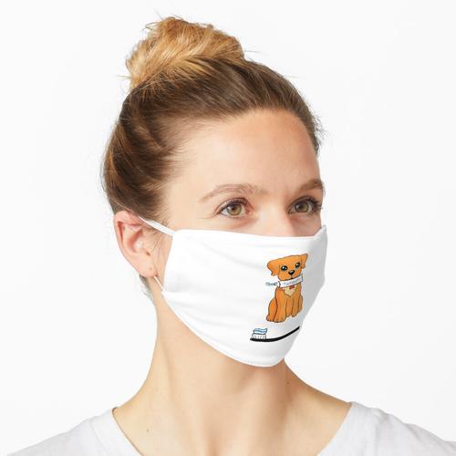 Welpe mit Zahnpasta Maske